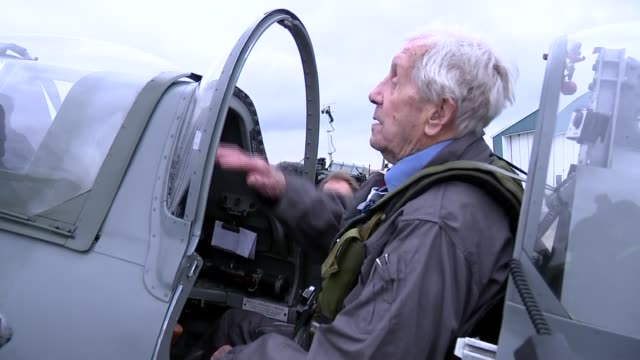 centenary: flypast at biggin hill; england: london: biggin hill airport: ext allan scott and mary ellis posing in front of spitfire jet on tarmac /... - biggin hill stock videos & royalty-free footage
