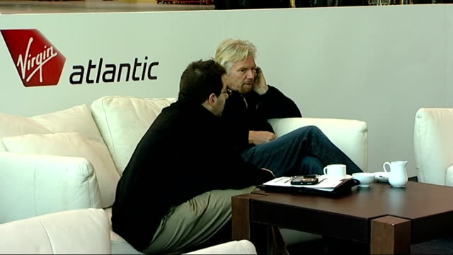 richard branson press conference and photocall england london heathrow airport int richard branson sitting talking on mobile phone drinking a hot... - conference phone stock videos & royalty-free footage