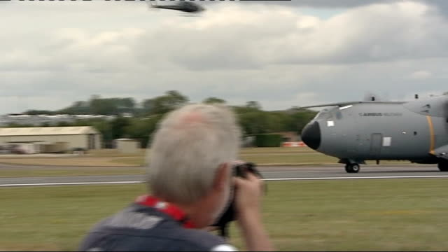 royal international air tattoo at raf fairford a400m aircraft in flight / a400m taxiing along runway / people sitting on helicopter / side view of... - raf fairford stock videos and b-roll footage