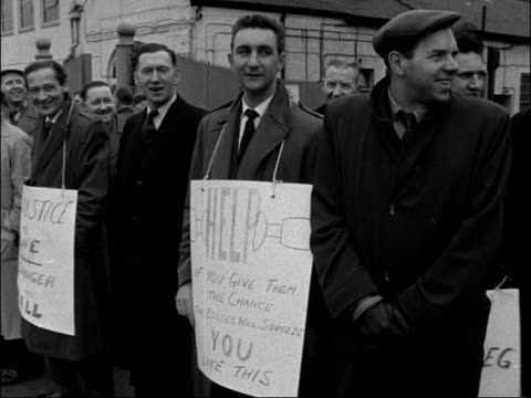 strike at de havilland aircraft company england greater london cricklewood ext workers on picket line during strike placard reading 'unity is... - greater london stock videos and b-roll footage