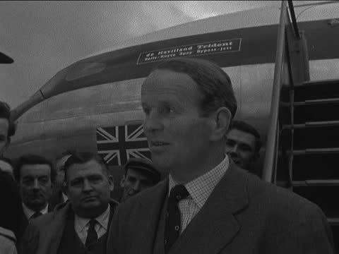 trident maiden flight; b) england: hertfordshire: hatfield: ext john cunningham in crowd: it is vastly more efficient in design, in wing form and in... - the alphabet stock videos & royalty-free footage