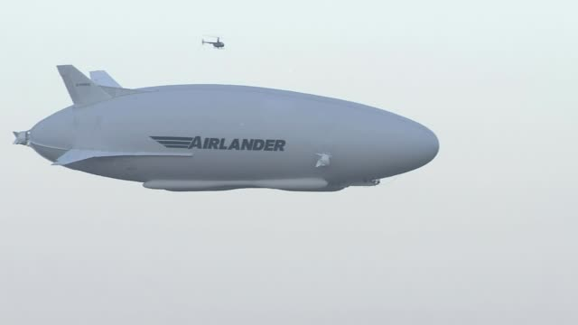World's largest aircraft Airlander 10 goes on maiden voyage Countryside TILT UP Airlander 10 flying overhead Airlander 10 in flight Stephen McGlennan...