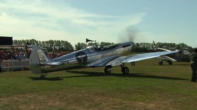 spitfire plane restored for round-the-world journey; england: west sussex: goodwood aerodrome: ext various of restored spitfire fighter plane with... - circumnavigation stock videos & royalty-free footage