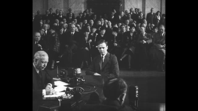 Aviator Charles Lindbergh sits in witness chair during session of US Senate Post Office Committee where he will testify concerning the air mail...