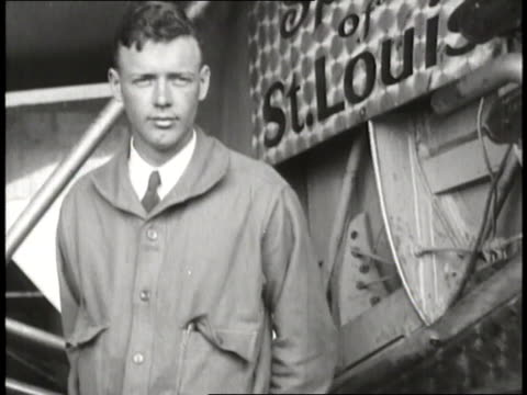 aviator charles lindbergh stands with his airplane the spirit of st louis - charles lindbergh stock videos & royalty-free footage