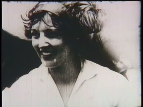 aviators amelia earhart and ruth elder are featured with their airplanes in a montage. - video collage video stock e b–roll