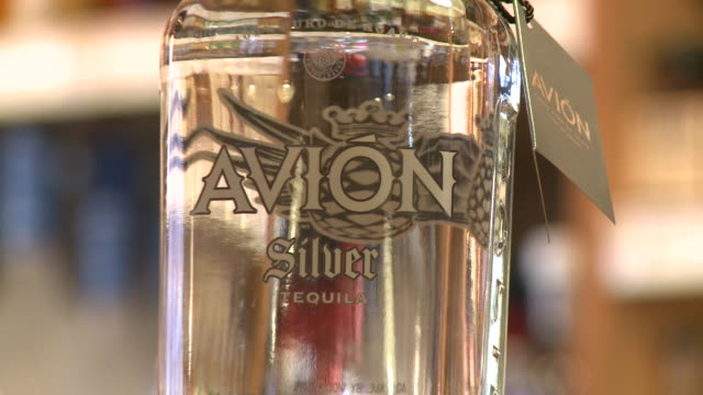 of avion silver tequila in store display - avion stock videos & royalty-free footage