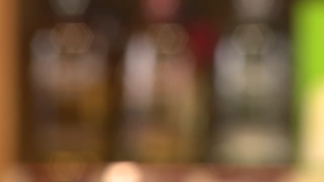 avion tequila bottles, panof interior of liquor store - avion stock-videos und b-roll-filmmaterial