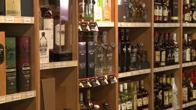 stockvideo's en b-roll-footage met of avion tequila on store shelf, logo - avion
