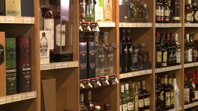 of avion tequila on store shelf, logo - avion stock-videos und b-roll-filmmaterial