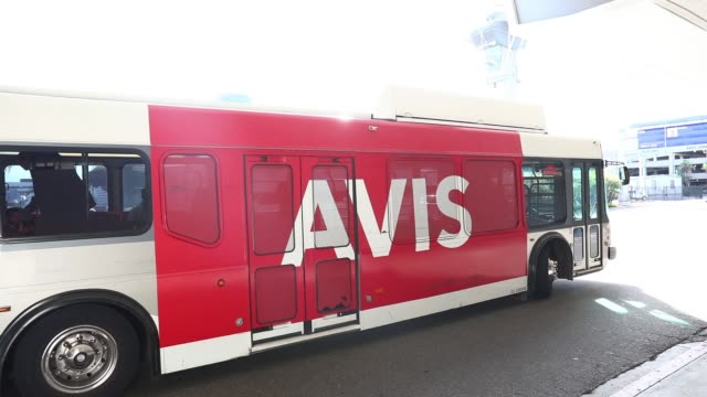 Avis Budget Group Inc shuttle buses drive through Los Angeles International Airport in Los Angeles California US on Tuesday Nov 7 2017 Photographer...