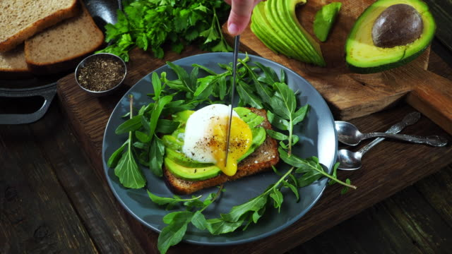 avocado and egg sandwich - toasted bread stock videos & royalty-free footage