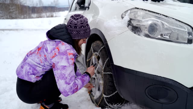 avoid traffic accident in winter-using tire chain - chain stock videos & royalty-free footage