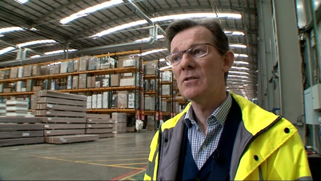 UK avoids triple dip recession Vehicle transporting materials in Travis Perkins warehouse Forklift truck reversing Forklift truck transporting...