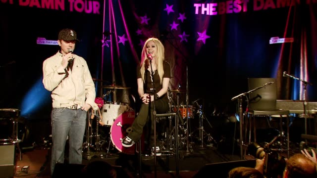 Avril Lavigne introduces the acoustic set and the band members at the Avril Lavigne acoustic performance at WhiskyAGoGo in Los Angeles California on...