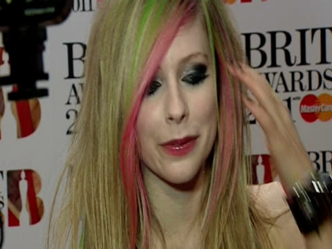 Avril Lavigne on her hair her outfit and more at the Brit Awards 2011 at London England