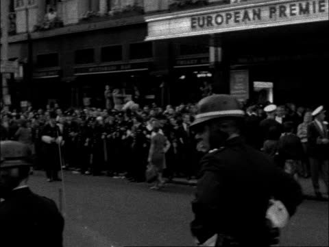 of cleopatra england london dominion av/ts sign cleopatra gv crowd pan across road to theatre cms anne heywoodl cms police control crowd cms yul... - cleopatra stock videos & royalty-free footage