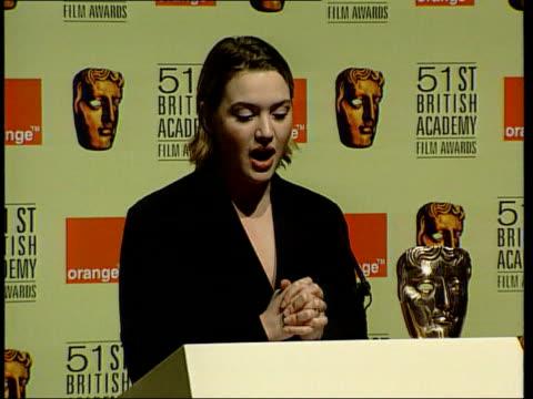 British dominance ENGLAND London Kate Winslet at podium announcing nominees for 51st BAFTA awards