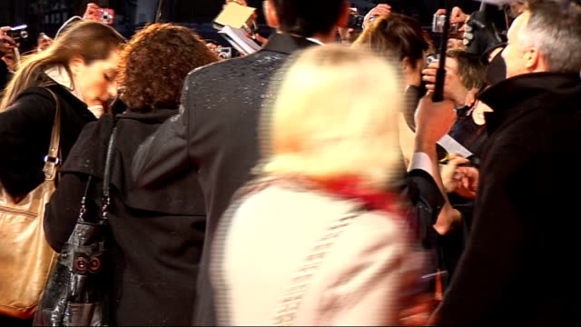 red carpet arrivals and interviews with itn on brad pitt and wife angelina jolie arriving together signing autographs for fans - brad pitt actor stock videos and b-roll footage