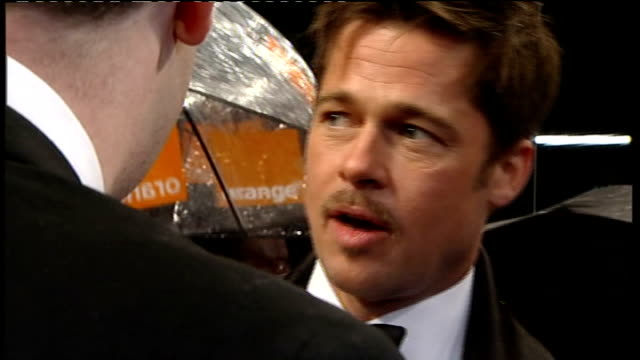 red carpet arrivals and interviews with itv news; robert downey jr surrounded by others / general views brad pitt and wife angelina jolie talking to... - brad pitt actor stock videos & royalty-free footage