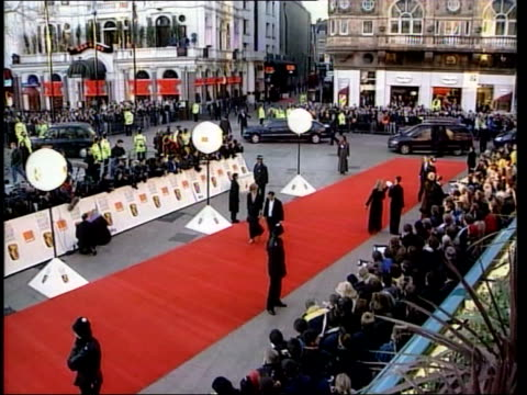 London Red carpet laid out for BAFTA film awards Actress Juliet Binoche Actor Albert Finney arriving