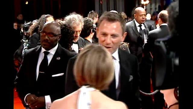 London INT Daniel Craig on red carpet Kate Winslet chatting to reporter Crowds waiting Back View Celebrities on red carpet