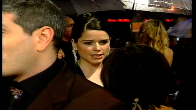 london leicester square ext ian mckellen chatting and kissing on red carpet neve campbell talking to reporter christina ricci along through crowd... - neve campbell stock videos and b-roll footage