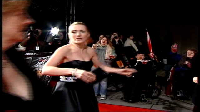 awards ceremony; winslet, wearing strapless black dress with silver belt, along on red carpet, waving and stopping to sign autographs for fans - strapless stock videos & royalty-free footage