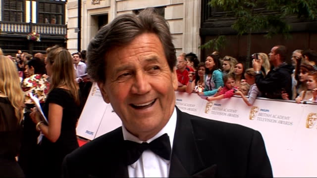 awards cermeony: arrivals and interviews; england: london: bafta awards ceremony: ext melvyn bragg talking to press on red carpet and interview about... - film award type stock videos & royalty-free footage