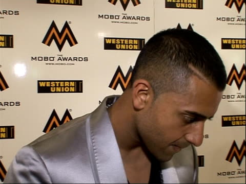 interviews with artists and award winners; jay sean interview sot - on performing at the ceremony - on playing at wembley arena - on estelle and... - wembley arena stock videos & royalty-free footage