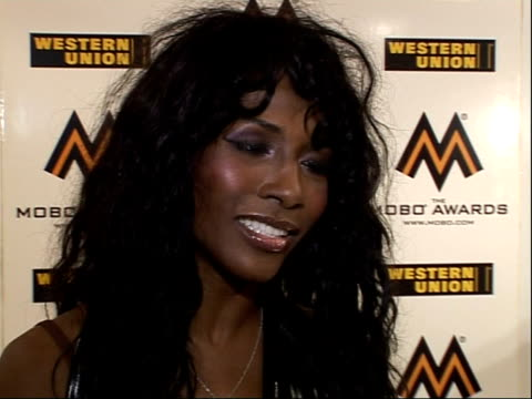 interviews with artists and award winners sinita interview sot on collecting the award on behalf of leona lewis on leona being recognised in the uk... - madonna singer stock videos and b-roll footage