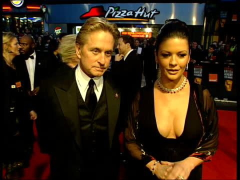 awards; itn england: london: leicester square ext/night actor michael douglas and actress catherine zeta jones sot - i think just to be acknowledged... - michael douglas stock videos & royalty-free footage