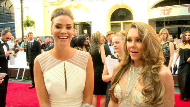 Red carpet interviews ENGLAND London EXT Michelle Heaton and Jessica Taylor interview SOT Aaron Paul chatting to press / Paul posing with people in...