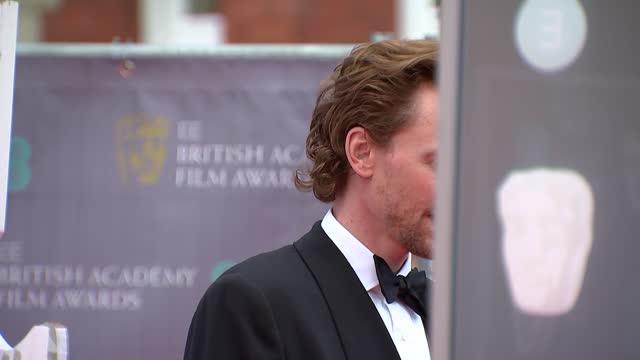 red carpet photocalls and interviews; england: london: royal albert hall: ext richard e grant interview sot / jonathan pryce gvs / tom hiddleston... - ジョナサン・プライス点の映像素材/bロール