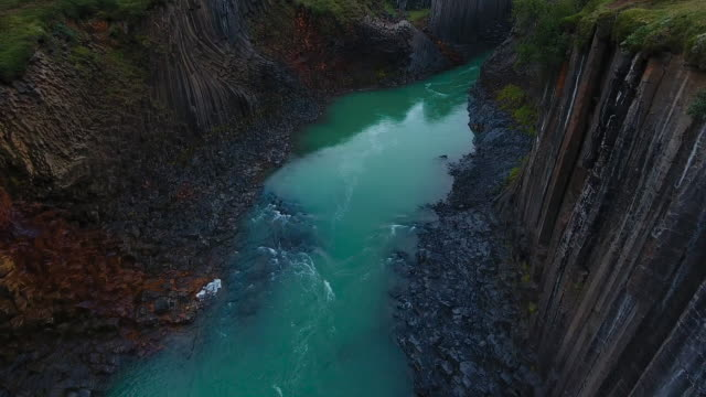 awesome basalt studlagil canyon in iceland. aerial view - basalt stock videos & royalty-free footage