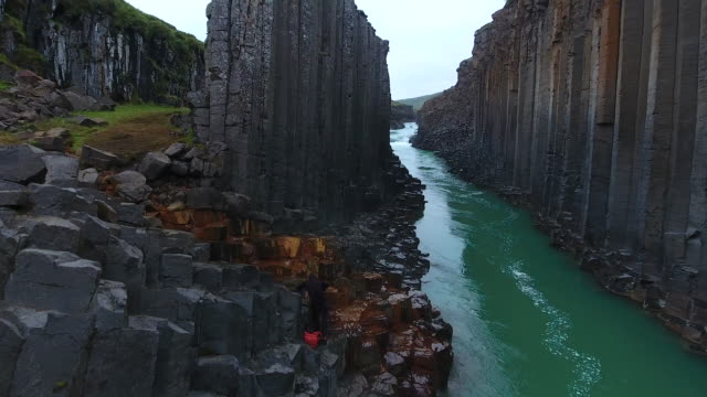 awesome basalt studlagil canyon in iceland. aerial view - canyon video stock e b–roll