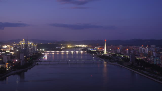 awesome sunset shot of pyongyang skyline in north korea, drpk. wide shot from above. day to night shot with juche tower, taedong river, may day stadium - communism stock videos & royalty-free footage