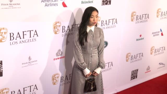 stockvideo's en b-roll-footage met awkwafina at the 2020 bafta tea party in los angeles ca - bafta awards