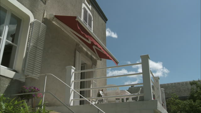 ms la awning opening above balcony, latour, belgium - awning stock videos and b-roll footage