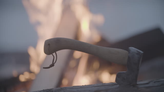 axe in wood in front of fire burning, slow motion - work tool stock videos & royalty-free footage