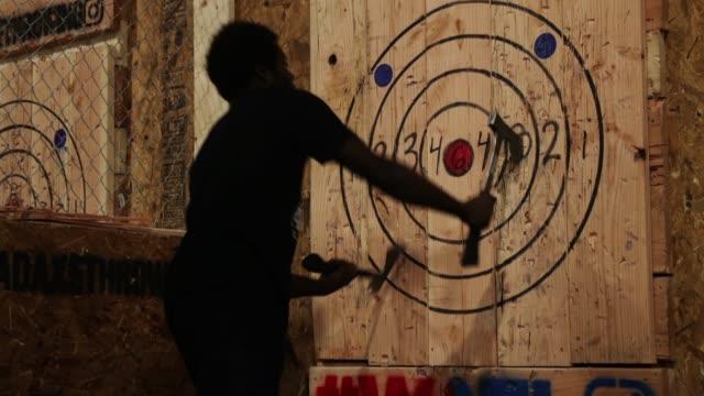 axe master omar cooper throws a hatchet at bad axe throwing march 28, 2018 in washington, dc. axe throwing is growing in popularity and bad axe --... - throwing stock videos & royalty-free footage