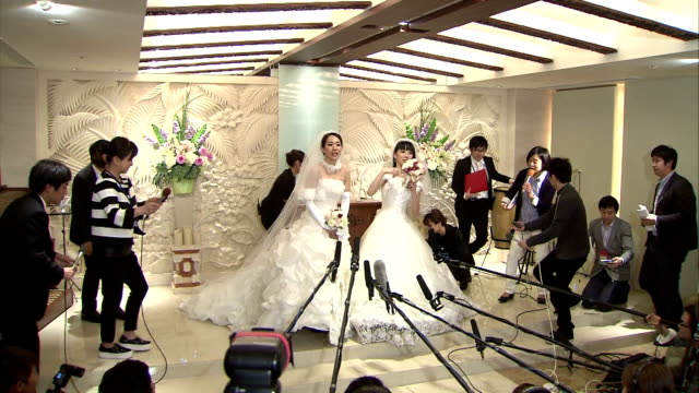 Ayaka Ichinose a 34yearold TV personality and her partner actress and dancer Akane Sugimori hold their wedding ceremony in Tokyo's Shinjuku Ward on...