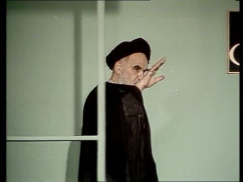 ms ayatollah khomeini iranian leader onto balcony waves to crowd gv same - iraq stock videos & royalty-free footage