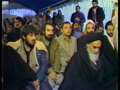 ayatollah khomeini prays with a group at a mosque. - 1970 1979 stock videos & royalty-free footage