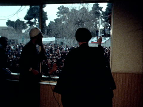 ayatollah khomeini walks towards the window to greet large crowd of followings chanting in support of his return from exile iran 3 february 1979 - イラン点の映像素材/bロール