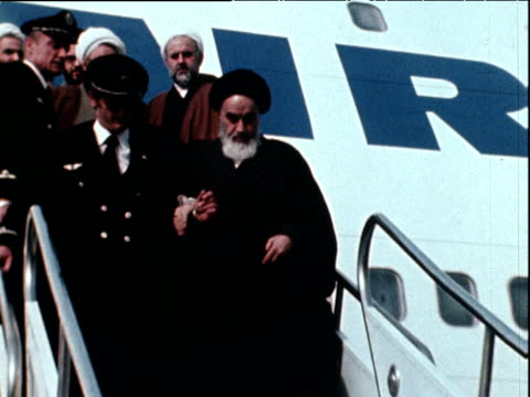 ayatollah ruhollah khomeini descends aeroplane steps on his return to iran after 15 years in exile 1 feb 79 - revolution stock videos & royalty-free footage