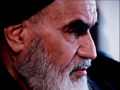 ayatollah ruhollah khomeini seated in plane returning to iran after 15 years in exile; 1 february 1979 - anno 1979 video stock e b–roll
