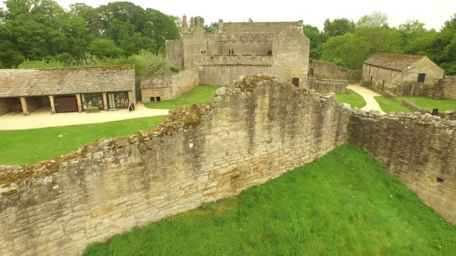 aydon castle aerial low fly over - circa 14th century stock videos & royalty-free footage