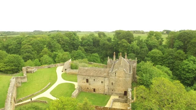 aydon castle aerial low right fly over - circa 14th century stock videos & royalty-free footage