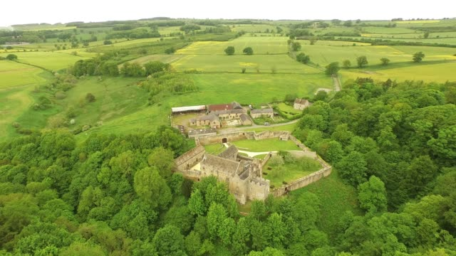 aydon castle - aerial track around from back - circa 14th century stock videos & royalty-free footage
